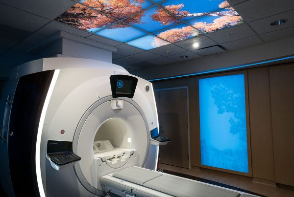 Custom Cedar City Caring MR Suite with Illuminated Image Sky Ceiling and MRI in bore viewing for best patient MRI experience